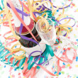 Champagne bottle and flutes on a party setting — Stock Photo