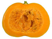 Round orange pumpkin cut in half — Stock Photo