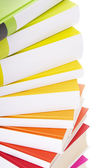 Pile of colorful books isolated on white — Stock Photo