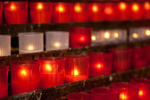 Burning candles for promise payment in catholic church — Stock Photo
