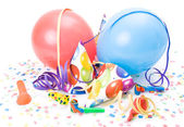 Party hats, horns or whistles, confettis and balloons on white background. — Stock Photo
