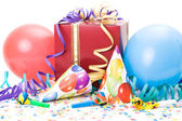 Gift, party hats, horns or whistles, confettis and balloons on white background. — Stok fotoğraf