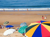Crowded beach at summer with sun umbrellas — Stock Photo
