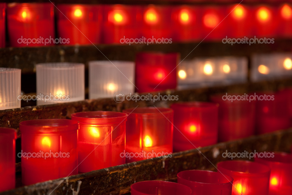 Burning candles for promise payment in catholic church — Stock Photo #13318777