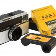 Old, vintage film cameras with photo paper, negative roll and case — Stock Photo #13320392
