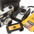 Old, vintage film cameras with photo paper, negative roll and case — Stock Photo #13320397