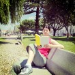 Woman reading book in park — Stock Photo