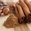 Stock Photo: Cinnamon sticks with ground cinnamon and beads