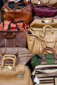 Old bags on a flea market — Stock Photo