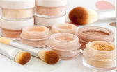 Cosmetic brushes and make-up — Stock Photo