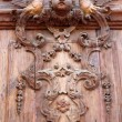 Foto Stock: Old carved wooden door