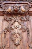 Old carved wooden door — Stock Photo