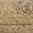 Ancient egyptian engravings depicting bulls on a mastab wall - Stock Photo