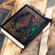 Holy book Koran on a table - Stock Photo