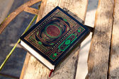 Holy book Koran on a table — Stock Photo
