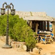 Stock Photo: Street lamp and beach cafe near Red sea