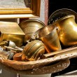 Old metal goods near antique shop — Stock Photo #13746474