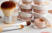 Cosmetic brushes and makeup — Stock Photo