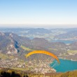 Paragliding over mountains and lake — Stock Photo