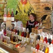 A stall with syrups and flavoring in bottles — Stock Photo