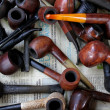 Tobacco pipes on a flea market — Stock Photo