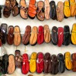 Sandals and slippers on a market — Foto de Stock