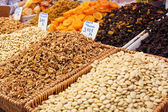 Nuts and dried fruits on the market — Stock Photo