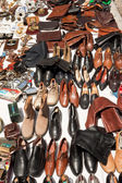 Shoes and bags on a flea market — Stock Photo