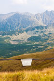 Stop sign in Tatra mountains — Stock Photo