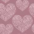 Ornamental lace hearts seamless pattern — Stock Vector