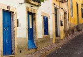 Doors on the street going uphill — Stock Photo