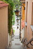 Narrow street with stairs and lamps — Stock Photo