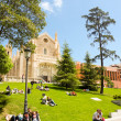 People relaxing on the grass near El Prado museum and St. Jerome — Stock Photo #49111025