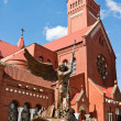 Постер, плакат: Statue of Archangel Michael and the Catholic Church of St Simon and Helena