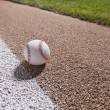 Baseball on a base path under lights at night — Stock Photo