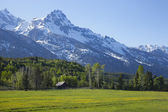 Horse ranch barn below the Grand Teton mountains of Wyoming — Stock Photo