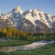 Grand Teton mountains with stream in morning light - Stock Photo