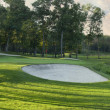 Panoramic view of golf green with white sand traps — Stock Photo