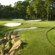 Golf green with traps and water - Stockfoto