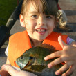 A young girl excited about her first sunfish — Stock Photo