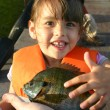 A young girl excited about her first sunfish - Stock Photo