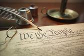 United States Constitution with quill, glasses and candle holder — Stock Photo
