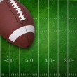 College football on grunge field background — Stock Photo #26677001