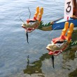 Stock Photo: Dragon boats wait for next race in Grand Marais, Minnesota