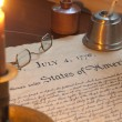 Declaration of Independence with candle holder, glasses and quil — Stock Photo