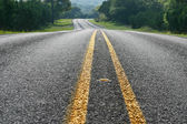 Low angle view of curving road in the Texas Hill Country — Stock Photo