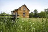 Early settlers' log cabin on the prairie — Stock Photo