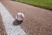 Baseball on a base path under lights at night — Stock Photo