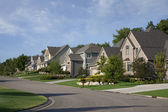 Houses on upscale suburban street in morning sunlight — Stock Photo