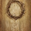 Crown of thorns on grunge wood background — Stock Photo